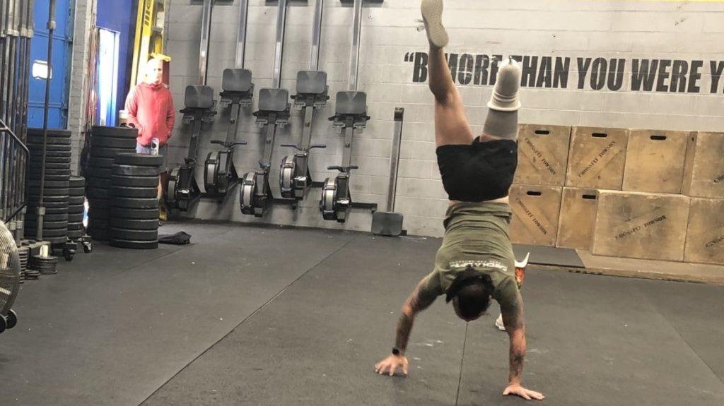 veteran doing handstand